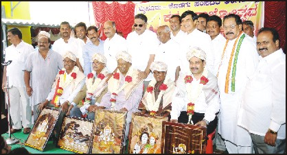Seen are (from right) Rajyotsava awardees Dr. Vasanthkumar Thimakapura, Bannur Kempamma, Dr. N. Rathna, Dr. V. Lakshminarayan and My.Na. Gopalakrishna with City Congress President C. Dasegowda, MDCC Bank President C. Basavegowda, MP Vishwanath, MLA Tanveer Sait, ZP President Mahadevu, Mysore District Kannada Sahitya Parishat President M. Chandrashekar and others during the felicitation ceremony at the MP's office at Govt. Guest House in city this morning.
