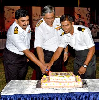 Flag Officer Commanding-in-Chief Eastern Naval Command Vice Admiral Anil Chopra along with Commanding Officer INS Circars Commodore Saleem M. Anwer cutting a cake to celebrate the 74th anniversary of ENC Depot Ship INS Circars in Visakhapatnam on Thursday./ by Special Arrangement / The Hindu