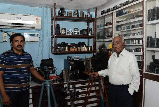 Mohammed Aquil (left) with his father Mohammed Abdul Latheef at Camera Crafts./ Photos: K.V. Srinivasan / The Hindu