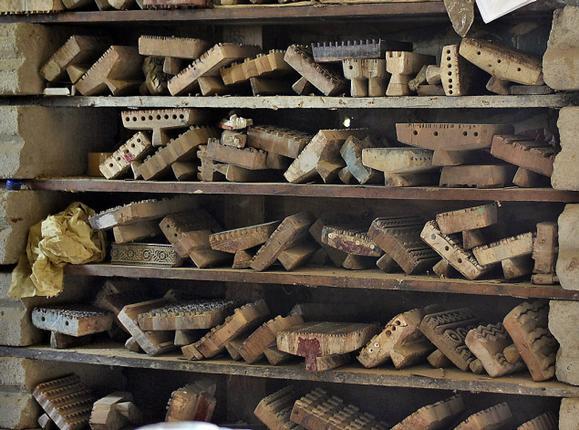 Stacks of ajrakh blocks at Jabbar Khatri's workshop in Dasada, near Bhuj