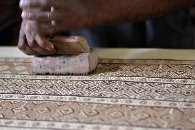 The ajrakh block printing process at Jabbar Khatri's workshop in Dasada, near Bhuj / The Hindu