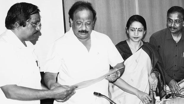 Chairman of the State Film Awards selection committee, K C N Chandrashekhar (left), handing over the list of winners to Information Minister Roshan Baig on Monday