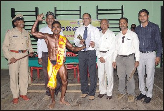 "Nagaraj (second from left) of Govt. First Grade College, Siddarthnagar, Mysore was crowned as the ""Mr. MCICT 2014"" in the Best Physique Competitions 2014, conducted by the Department of Physical Education, UoM at the University Gymnasium Hall on Thursday. Seen in the picture from left are B.D. Kantharaj, Dr. C Krishna, Director, DPE, UoM (third from left), Prof. Seshanna, Anthony Moses and Lohith, Physical Education Director, GFGC, Siddarthanagar, Mysore."