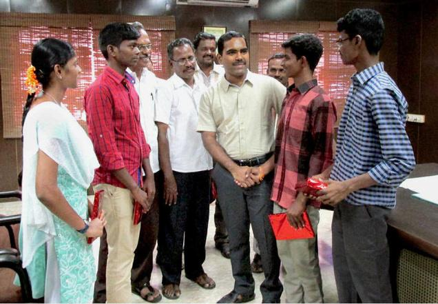 Collector (in-charge) Madhusoodhan Reddy congratulating the 'Super 30' group students who have been allotted seats in medical colleges, in Perambalur on Saturday.