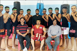 Seen in the picture are (from left) Kickboxing Coaches Abdul Razzack, Sumanth Subrahmanya, Aditya Bhat, Satyananda Bhat, Chethan C. Gowda, Head Coach of AMS Vikram, Naveen Shetty, M.J. Chethan, L. Srihari, Suleman Shariff and Badri Narayan Kandade. (Sitting): Group Capt.Srinath, Grand Master M.H.Abid and Trust President Rtn.M.S.Nandakumar, Trust President.