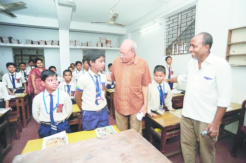 Mamoon Akhtar (right) with Emami co-founder RS Goenka during a visit to his school in Tikiapara. Picture by Sanjoy Chattopadhyaya