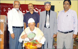 N. M. Ghouse Khateeb Nagmangali, renowned Urdu poet, who was felicitated by Anjuman-e-Urdu of Farooqia PU college in city yesterday, is seen with (standing from left) Prof.Riyaz Ahmed (President), Prof. Mohammed Ziaulla (chief guest), Prof. M. Sayeed Ahmed (Hon. Secretary) and Abdul Jabbar (Principal).