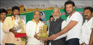 Former Mayor D. Dhruvakumar (third from left) is seen receiving the prize on behalf of his grandson Dhruvesh, who shared first place along with Venkatesh of Kolar (2nd from left) at the State-level Milking Contest, from Actor Darshan Thoogudeep and Animal Husbandry Minister A. Manju at J.K. Grounds in city yesterday. MLA H.P. Manjunath, Film Director Sandesh and others were present