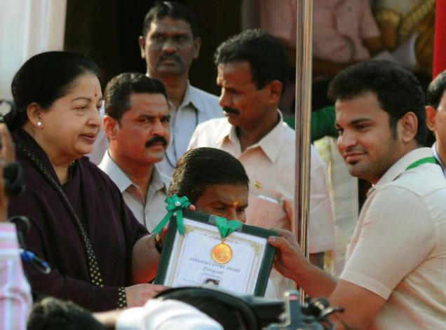 Tamil Nadu Chief Minister J. Jayalalithaa presenting Bravery award to Mohammed Yunus during the 67th Republic Day Celebrations at Marina on Tuesday. Photo: R. Ragu / The Hindu