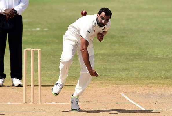 Indian cricketer Mohammed Shami delivers a ball the three-day tour match between India and WICB President's XI squad at the Warner Park stadium in Basseterre, Saint Kitts, on July 14, 2016. / AFP / Jewel SAMAD (Photo credit should read JEWEL SAMAD/AFP/Getty Images)
