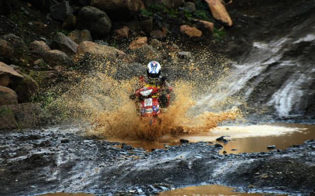 A rider at the rally negotiates the tricky and slushy course. Photo: Vijay Bate.