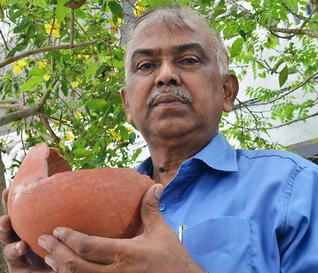 Historian Mohammed Silar with a pot collected from a Buddhist site at Gudivada in Krishna district.