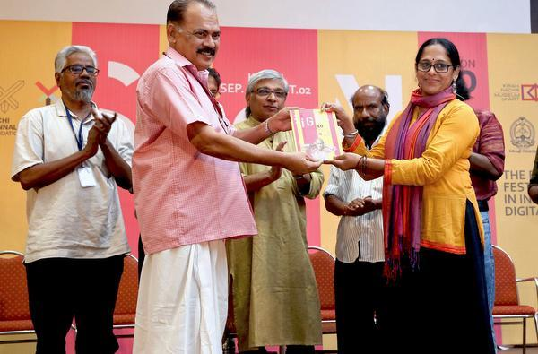 Former MP Sebastian Paul presenting the first copy of SiGNS festival book to actor Sajitha Madathil during the inaugural function of SiGNS 2016 in Kochi on Wednesday.— PHOTO: by special arrangement