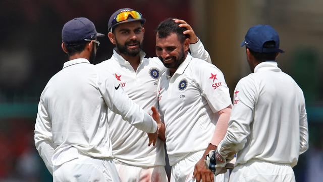 India's Mohammed Shami celebrates with teammates after taking the wicket of New Zealand's Mark Craig. (REUTERS)