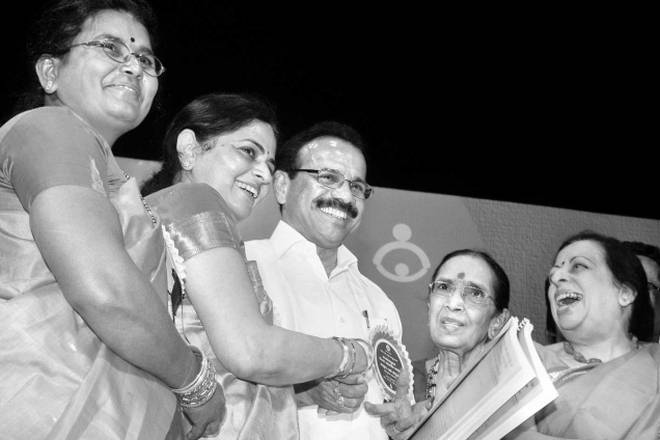 ACHIEVERS:Chief Minister D.V. Sadananda Gowda and his wife, Datty, sharing a light moment with winners of the Kittur Rani Chennamma Award in Bangalore on Thursday.— Photo: V. Sreenivasa Murthy