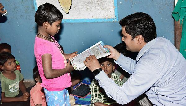 Reaching out:Collector Sarfaraz Ahmed teaching at Government Social Welfare Residential School at Jammikunta in Karimnagar district on Friday.- Photo: By Arrangement
