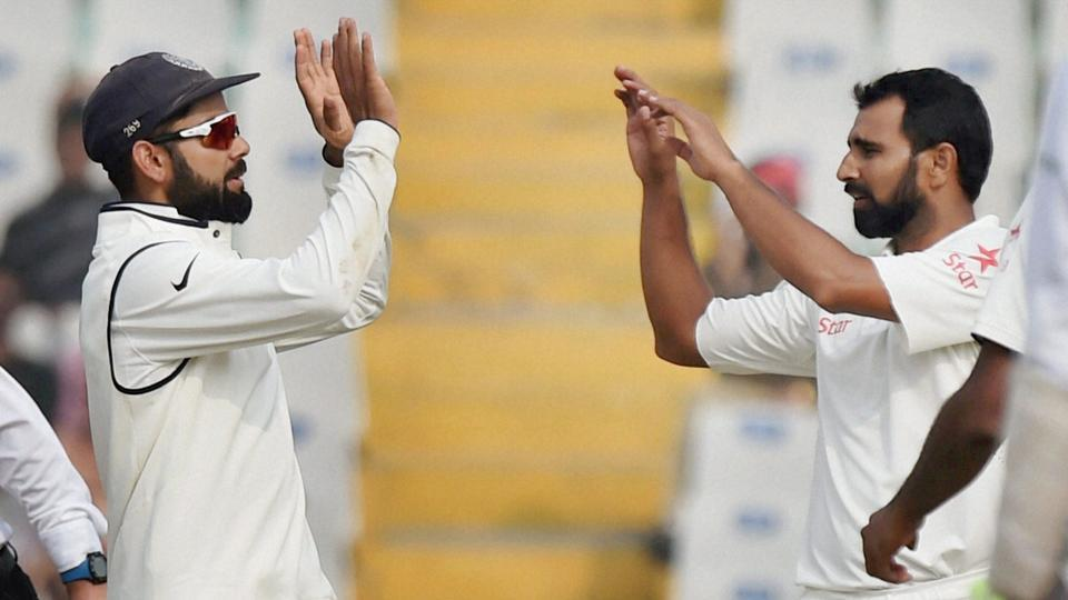 India captain Virat Kohli celebrates with Mohammed Shami the wicket of England batsman Adil Rashid, on the fourth day of the third Test match between India and England in Mohali on Tuesday. PTI Photo by Vijay Verma(PTI11_29_2016_000081B) (PTI)