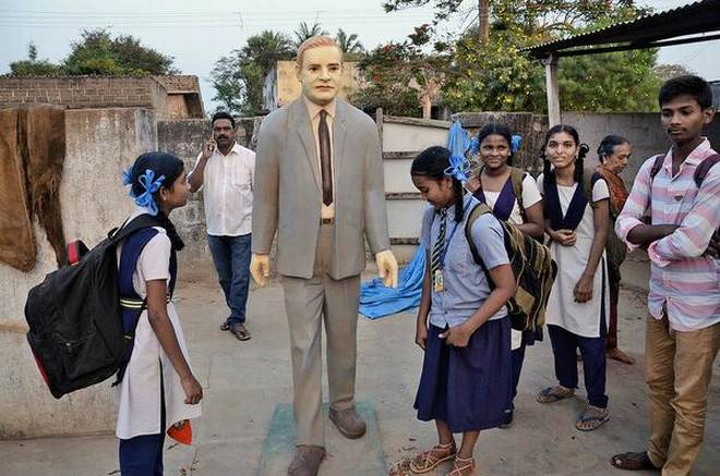 In fond memory: Villagers of V. Venkatayapalem looking at the statue of late Zaheer Ahmad to be installed at a housing colony, in Khammam district. | Photo Credit: G_N_RAO
