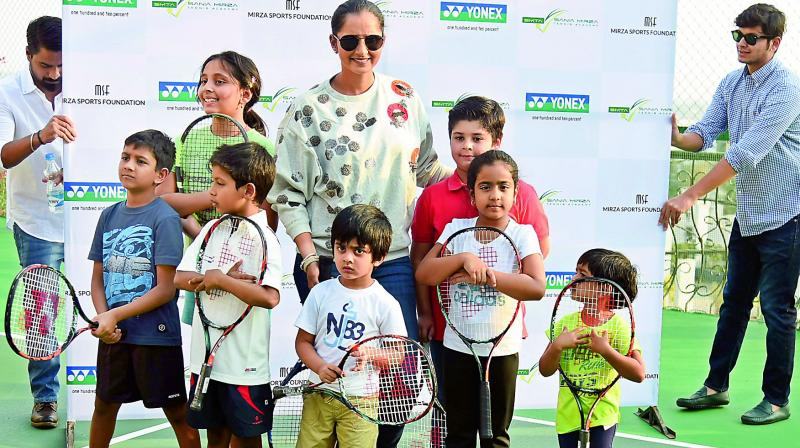 Sania Mirza poses with kids at the newly-opened Grassroot Level wing of the Sania Mirza Tennis Academy next to her house in Jubilee Hills on Monday (Photo: R. Pavan)