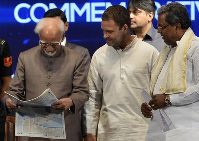 "Vice President Hamid Ansari, AICC vice president Rahul Gandhi, and Chief Minister Siddaramaiah during the release of National Herald's commemorative publication, ""70 years of India's Independence"" on Monday. Photo: Bhagya Prakash K."