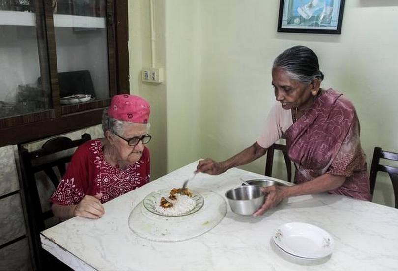 Simple repast: Seli serving lunch to Sarah. PHOTO: THULASI KAKKAT