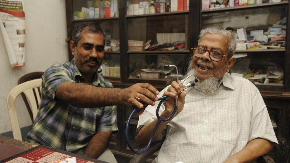Compounder Debprasad Bairagi (left) has been working for the last 35 years with Dr Kaseed Ali (right) in Basirhat.(Samir Jana/HT PHOTO)