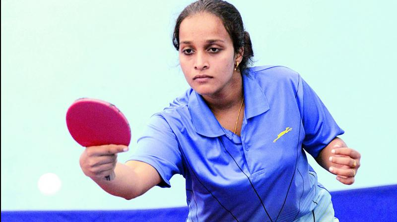 Nikhat Banu plays a shot on way to winning the women's title at the 3rd Telangana state ranking tournament.