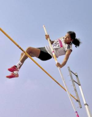 SOARING HIGH: A. Nisha Banu of Tamil Nadu, who won the pole vault gold in the girls' under-20 category.