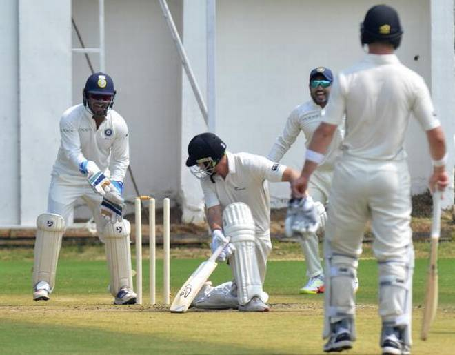 Oh no! New Zealand-A opener George Worker looks back to see his bails dislodged by Karn Sharma. | Photo Credit: V RAJU.