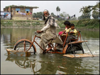 Saidullah takes his grandchildren for a joy ride in his cycle-rickshaw