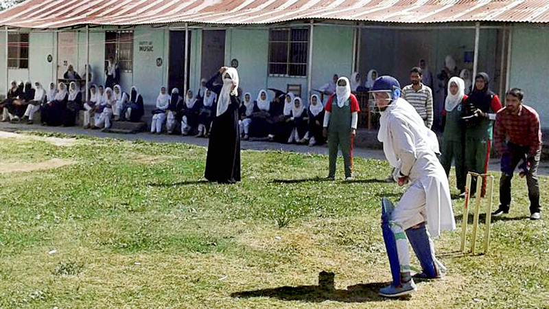Baramulla : Nothing stops them. Woman cricketers in burqa and hijjab at Baramulla defying social restrictions in their passion for the sport. PTI Photo (STOTRY DEL18)(PTI10_2_2017_000055B)