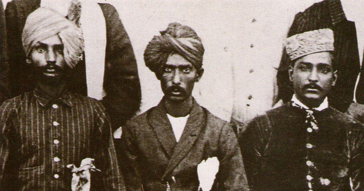 Abdul Karim Khan (centre)