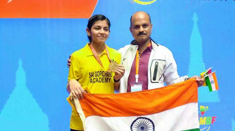Samiya Imad Farooqui poses alongside junior chief coach Sanjay Mishra in Yangon on Sunday.