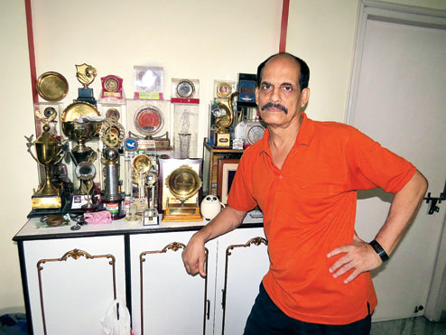 Moidul Islam poses with his trophies at his FD Block home. (Sudeshna Banerjee)