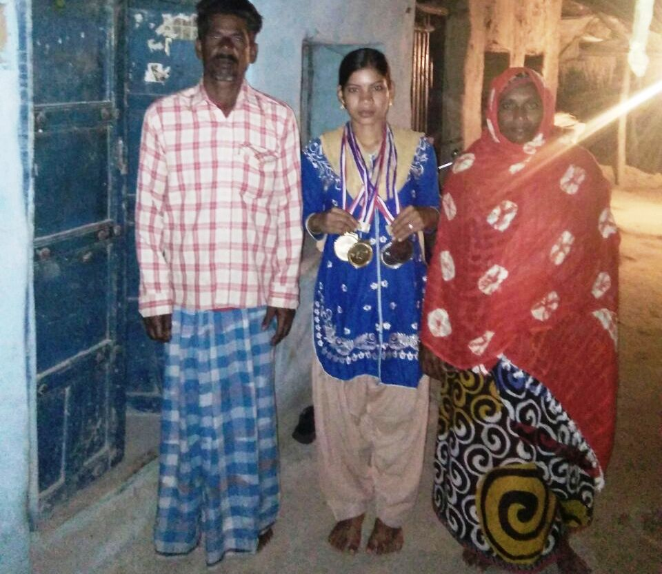 Samima with her parents in her home.