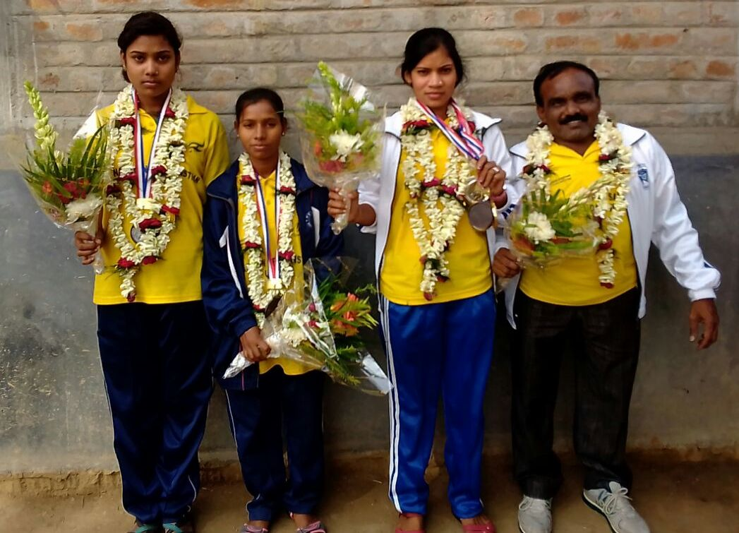 Resmita, Saina and Samima are being felicitated in their locality with their Coach
