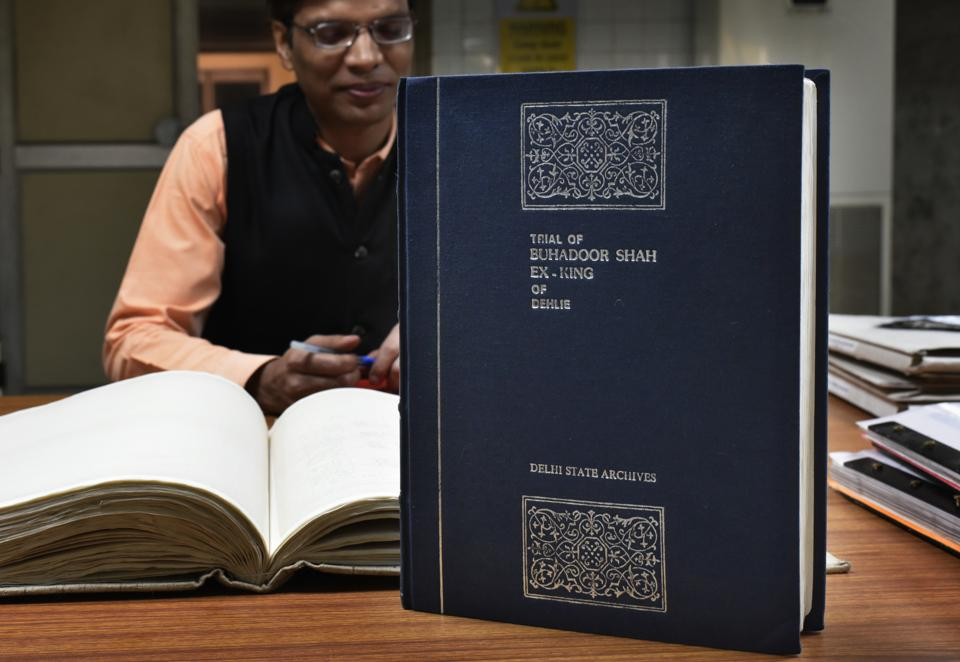 An official with a copy of the trial of Bahadur Shah Zafar. (Vipin Kumar/HT PHOTO)