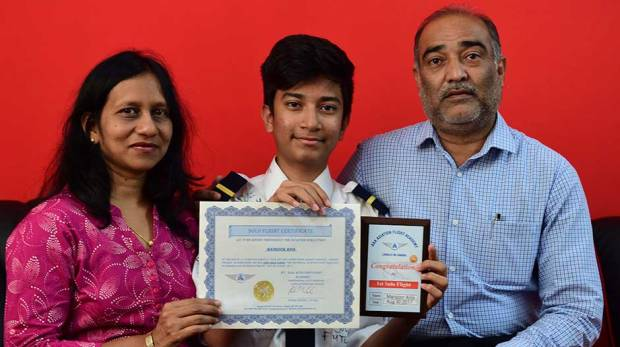 Mansoor, with his parents Munira and Ali Asgar, displays the certificate he earned from an aviation academy / Image Credit: Atiq ur Rehman/Gulf News
