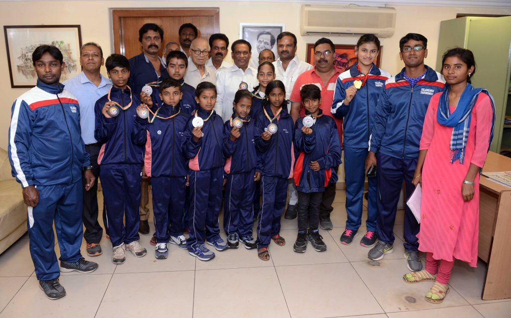 The Telangana taekwondo who won laurels in the national meet with SATS chairman A Venkateshwar Reddy and others.