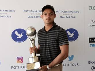 Bengaluru golfer Syed Saqib Ahmed with the PGTI Cochin Masters Trophy, his maiden pro title, on Saturday. - STAN RAYAN